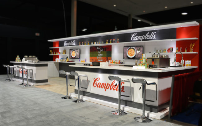 Campbells trade show booth counter with stools