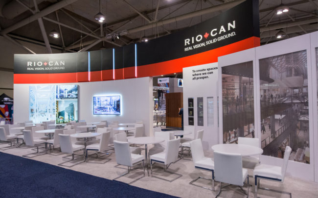 Riocan trade show booth with many meeting tables